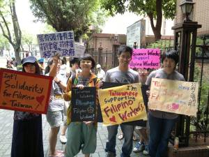 Young Taiwanese demonstrate support for Filipinos on the streets of Taipei