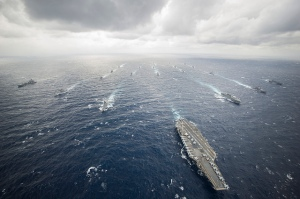 The aircraft carrier USS George Washington (CVN 73), center-right, leads the George Washington Carrier Strike Group and Japan Maritime Self-Defense Force ships in tactical maneuver training during Annual Exercise (AnnualEx) 13. Image Credit: CC BY 2.0 Official U.S. Navy Page/Flickr.