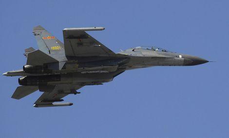 PLAAF Su-27/J-11 fighter jet could soon be enforcing ADIZ using air strip on Fiery Cross Reef. Image Credit: U.S. Department of Defense