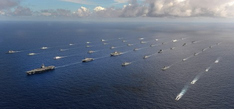 Forty-two ships and submarines representing 15 international partner nations manuever into a close formation during Rim of the Pacific (RIMPAC) Exercise 2014. Image Credit: CC by Stuart Rankin/Flickr.