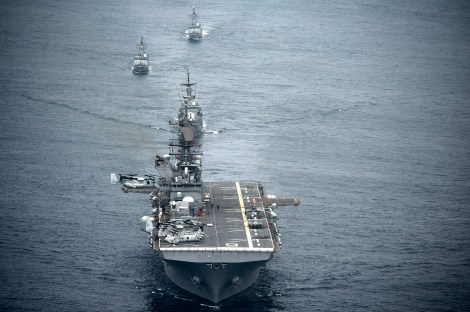 The amphibious assault ship USS America (LHA 6), front, and Peruvian Navy ships sail in formation during a passing exercise in the Pacific Ocean Sept. 3, 2014.  LHA-6 serves similar purpose as Mistral-class amphibious attack ships. Image Credit: CC by U.S Department of Defense/Flickr.