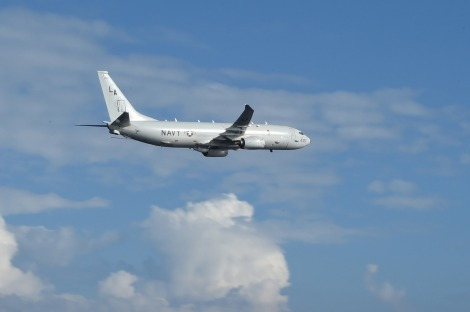 A P-8A Poseidon from Patrol Squadron Five (VP-5) flies by the amphibious assault ship USS Peleliu (LHA 5) during a routine exercise in the Philippines Sea. Poseidons are likely to conduct majority of air patrols by the U.S. Navy in the South China Sea. Image Credit: CC by U.S. Pacific Fleet/Flickr.