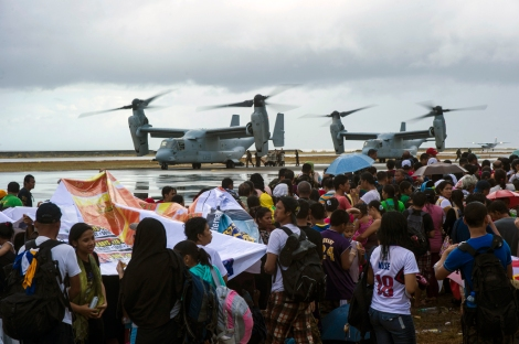 "MV-22 Ospreys assigned to the Marine Medium Tiltrotor Squadron 261, 1st Marine Aircraft Wing, take on supplies to provide aid during ""Operation Damayan."" The George Washington Strike Group supports the 3rd Marine Expeditionary Brigade to assist the Philippine government in response to the aftermath of Super Typhoon Haiyan/Yolanda in the Republic of the Philippines. Image Credit: CC by U.S. Pacific Command/Flickr."