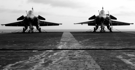Two Dassault Rafale multi-role fighter jets aboard France's only aircraft carrier R91 Charles de Gaulle. Image Credit: CC by Pascal Subtil/Flickr.