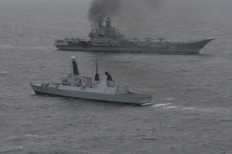 HMS Dragon (foreground) with the Russian aircraft Carrier 'Admiral Kuznetsov'. HMS Dragon, a Type 45 Destroyer and one of the Royal Navy's most technically advanced warships, was able to pinpoint and monitor the movement of the seven-strong group led by Russian aircraft carrier Admiral Kuznetsov as it approached the UK. Chinese aircraft carrier Liaoning is Kuznetsov's sister ship. Image Credit: CC by U.K. MoD/Wikimedia Commons.