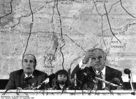 Franco-German reconciliation has been crucial for the success of post-War European integration. On this photo, dated 24 Sptember, 1987, French President François Mitterand and Chancellor of Germany Helmut Kohl address press during joint military exercise. Image Credit: Wikimedia Commons